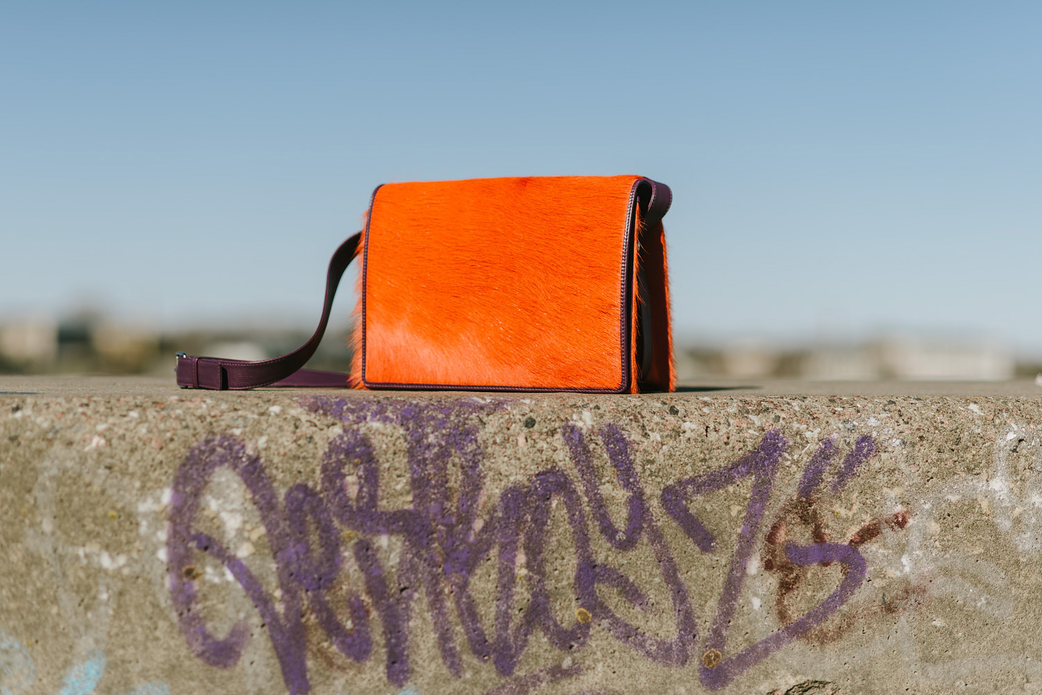 Orange leather bag by Stella Soomlais photo Tnu Tunnel